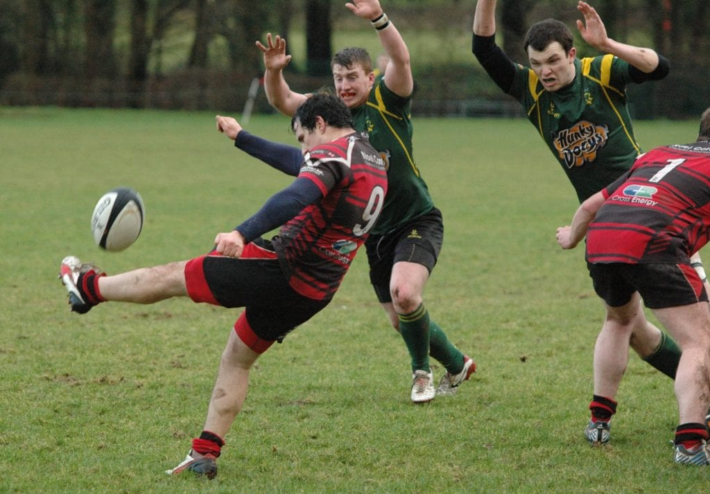 Scrum-Half Harry Doyle clears with a box kick