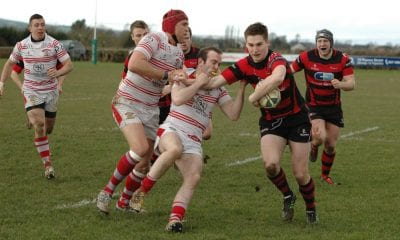 City of Armagh's out-half, Cowan, almost scored