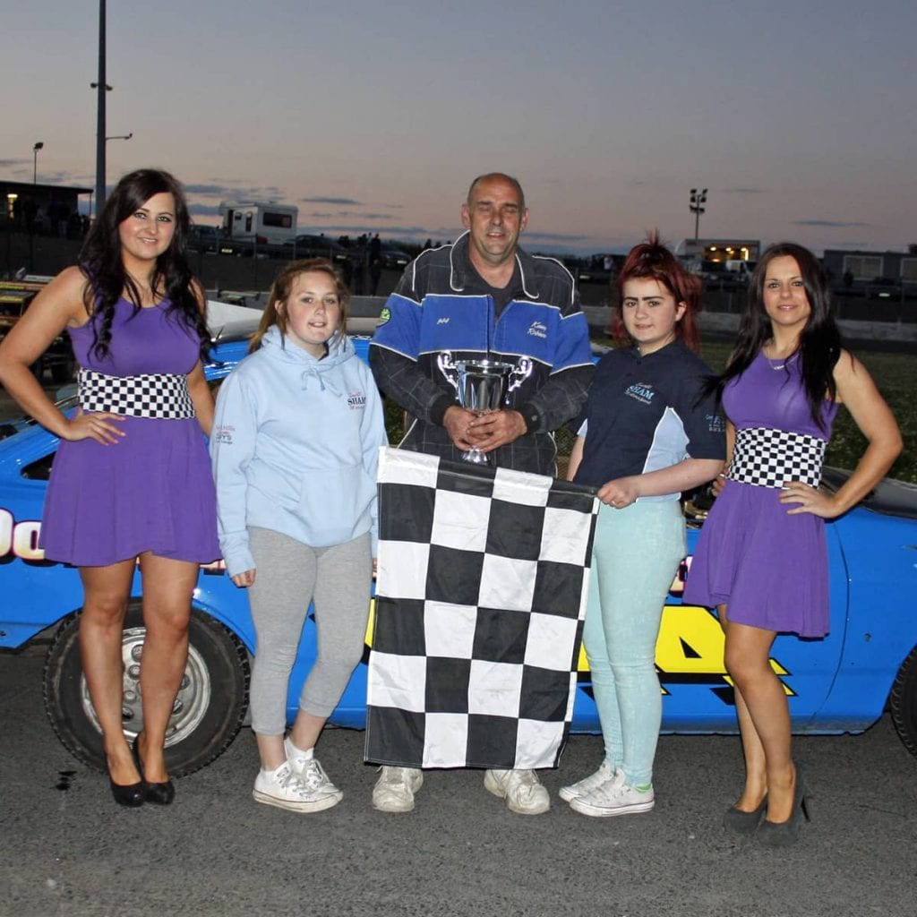 Winner of the Lightning Rods final at Tullyroan Oval on Saturday night is presentined with the trophy by Shannon Ward and Kiera McConnell representing ASC Cars