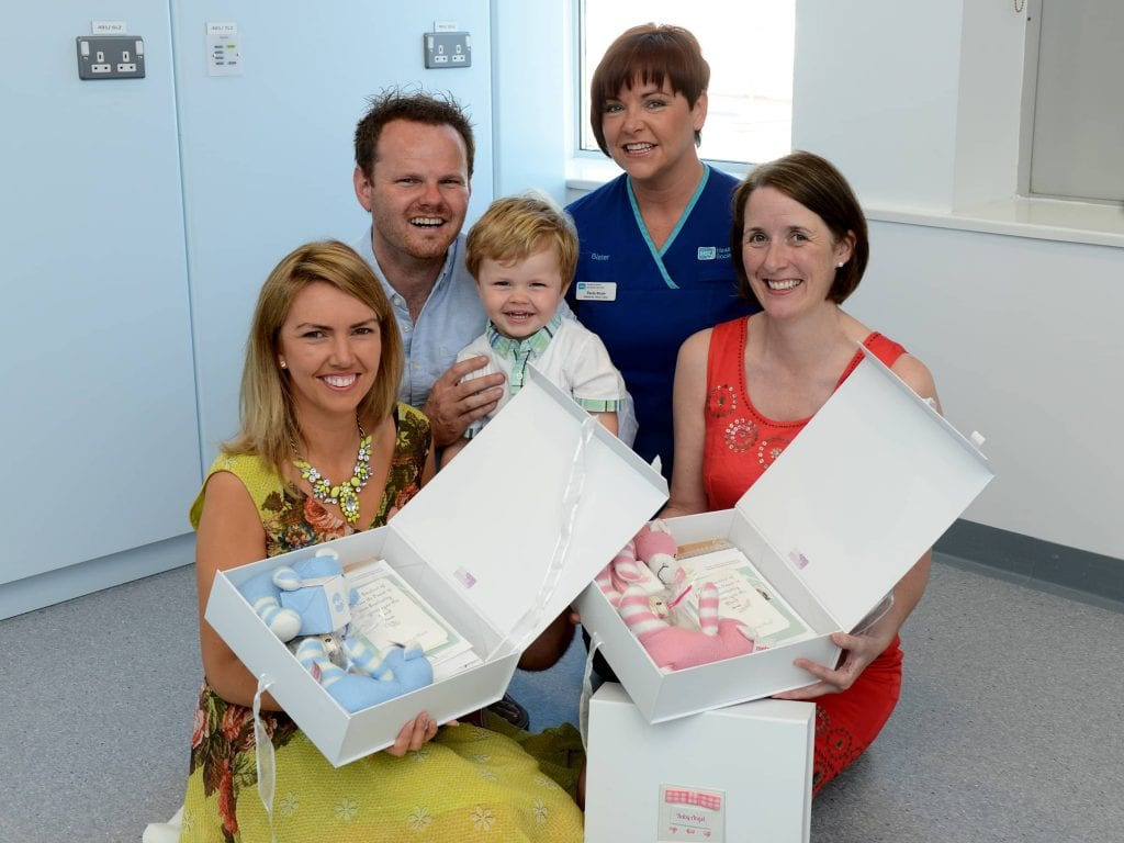 Kerri Marie and John Boyle with their son Noah presenting memory boxes to Sister Paula Boyle, Maternity Ward, Daisy Hill Hospital and Brenda Kelly, Lead Midwife, Southern Health and Social Care Trust.