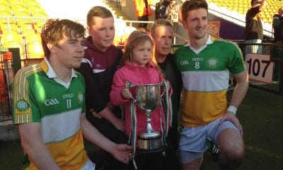 Feidhlim O'Neill (8) with Andrew Murnin