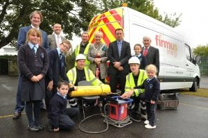 Sealing the time capsule at Mount St Catherine's PS on Friday, October 3rd included pupils, Ryan Maughan, Rhiannon Reilly, Emmet Murray and Abigail Armanaviciute with McNicholas technicians, Joe Baxter and Christopher Kelly. They were accompanied by (back from left) firmus energy managing director, Michael Scott, McNicholas head of operations, Cormac O'Donnell, Lord Mayor, Cathy Rafferty, school principal, Peter Gildea and McNicholas operations director, Mike Caulfield.