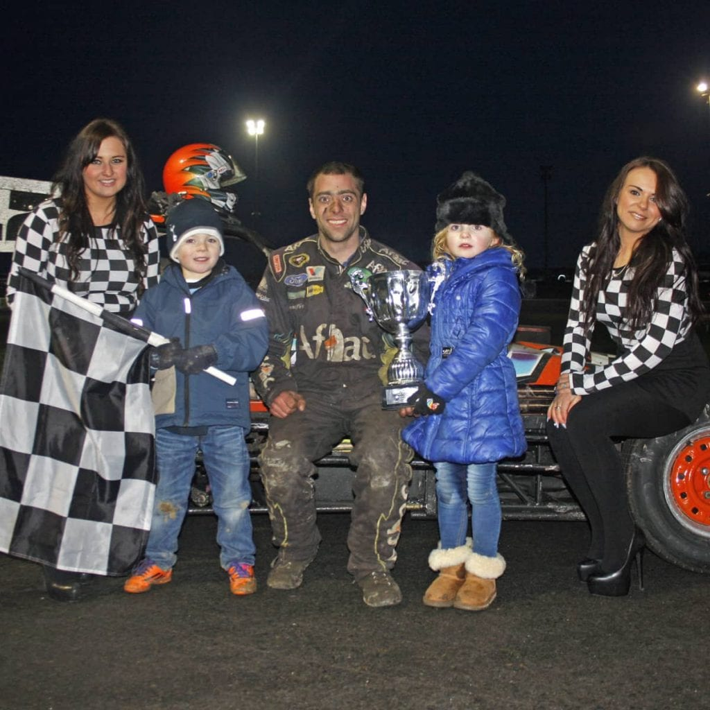 Gary Grattan won the Superstox Final At Tullyroan Oval on Sunday, he is pictured here receiving his trophy from Callum and Jessica Doak on behalf of meeting sponsor Cirrus Plastics