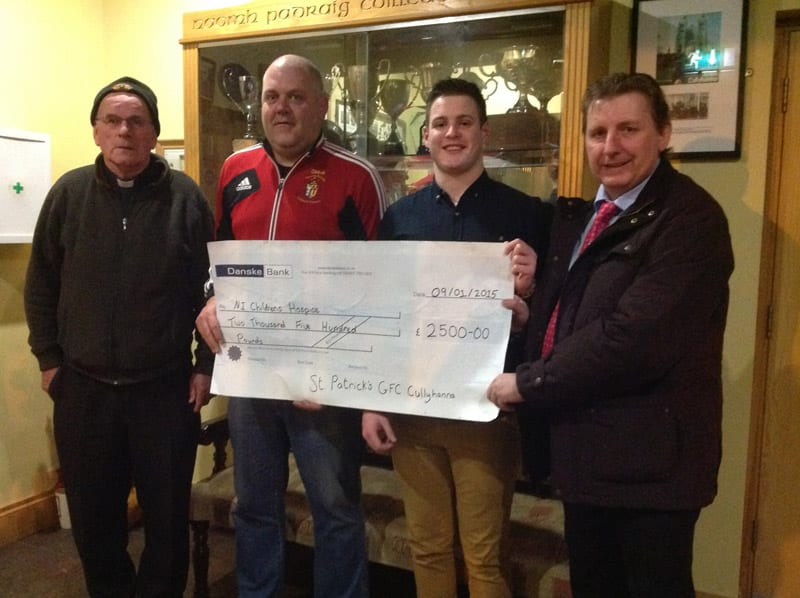 Father Kevin Cullen, Gary McKeown and Kevin Hoey of St. Patrick's GFC Cullyhanna were delighted to present of cheque worth £2500 to Martin Murphy representing Northern Ireland's Children's Hospice, following a successful fundraising event.
