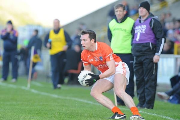 Tony Kernan in possession for Armagh. Photo by John Merry