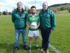 Kieran Malone (Malone Monumental), who sponsored our senior game on Sunday, presents the match ball to senior team captain Micheál Brady. Also pictured is Shane O'Neill's vice-chair, Mickey Mackin.