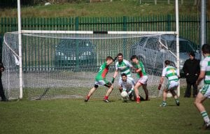 Darren McAvoy saves and feeds the ball out