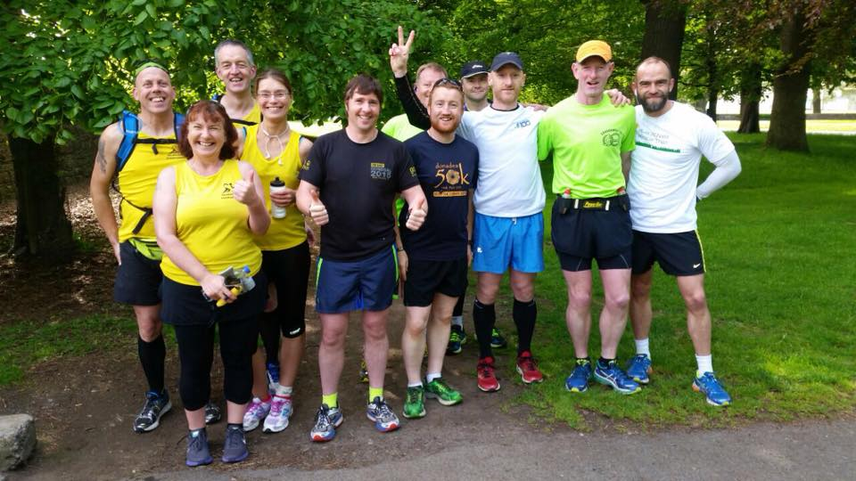 Stevie McGeown (centre thumbs up) with fellow runners