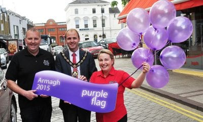 Celebrating the city's latest success with Lord Mayor, Armagh City, Banbridge and Craigvon Borough Council, Darryn Causby, is Malachy O'Neill, Chair of Armagh City Centre Management and Teresa McGee, Manager of Rumour Espresso Bar.