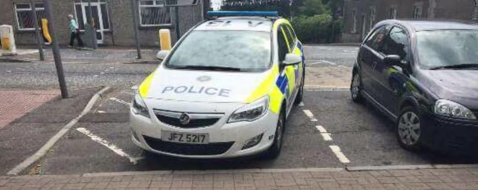 Police parked in a disabled parking spot without a blue badge displayed. Photo taken in Richhill Pic: M. Cloughley