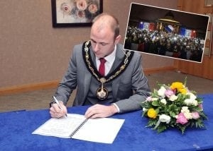 Lord Mayor of Armagh City, Banbridge and Craigavon Borough Council, Councillor Darryn Causby opens the book of condolence at Craigavon Civic Centre.