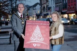 Getting ready for the switch on is Lord Mayor of Armagh, Banbridge, Craigavon, Cllr Darryn Causby with singer Emma Horan.