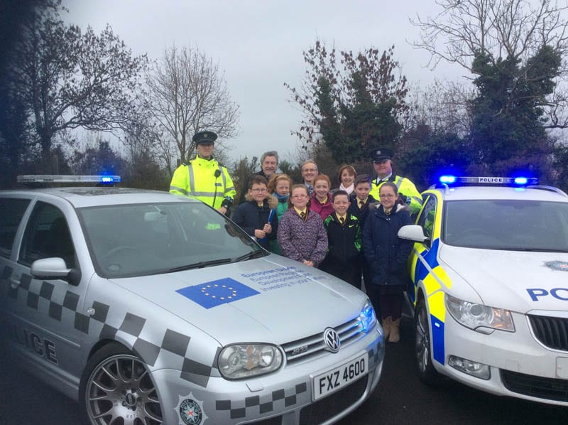Cllr Roisin Mulgrew with MP Mickey Brady, Principal Kearns, pupils from St Malachy's and officers from the PSNI road safety team