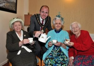 Lord Mayor of Armagh City, Banbridge and Craigavon, Councillor Darryn Causby with Emily Birch, Jean Dale and Jean Anderson who are all celebrating their 90th Birthdays.