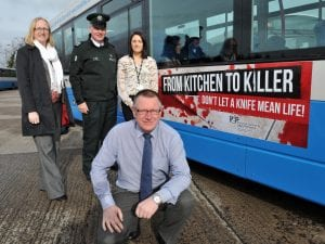 Alderman Robert Smith, Chair of the Policing and Community Safety Partnership with Alison Clenaghan, PCSP manager, Sergeant Billy Wilson, PSNI and Aisling Gillespie. PCSP project co-ordinator with the new 'Knife Crime' campaign posters on buses.