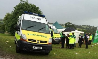 A woman is help ed by ambulance crew in Scarva. Pic: Derek Hutchinson