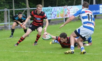 Armagh's full-back Timmy McNiece has to reach for Armagh's bonus point try
