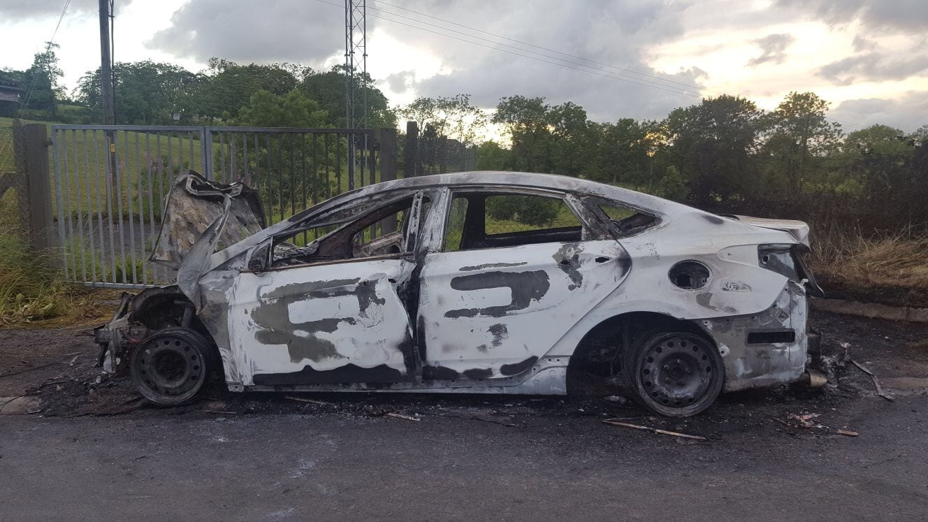 Burnt out car on Dundrum Road, Tassagh