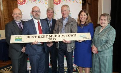 Winner in the Best Kept Medium Town Category of the NI Best Kept Awards is Armagh. Dave Foster, Department of Agriculture, Environment and Rural Affairs, Joe Mahon, Patron of the NI Amenity Council, Michelle Hatfield, Human Resources and Corporate Responsibility Director at Belfast City Airport and Doreen Muskett, President of the NI Amenity Council, present Armagh, Banbridge, Craigavon Council representative Barry Patience and Martin Kearns with their award. The judges noted that the strong historical connection of Armagh was beautifully realised by business people and residents who took pride in the town and its appearance.