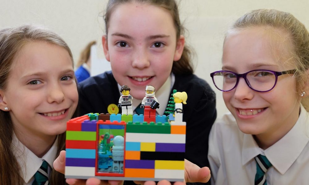 From left: Drumhillery Primary School students Wictoria Gleinart, Eva Robinson and Nicola Gleinart show off their Lego creation. The Lego Mindstorm project brings children and teachers from primary schools together for Lego Mindstorm Workshops and subsequently for Space Challenge Competitions and Exhibitions of Project work and Project Sharing ideas. Peace by PIECE Lego Mindstorm funded by Peace IV co-ordinated by CMETB Tommy Makem Centre Keady Co.Armagh 9 3 2019 CREDIT: LiamMcArdle.com