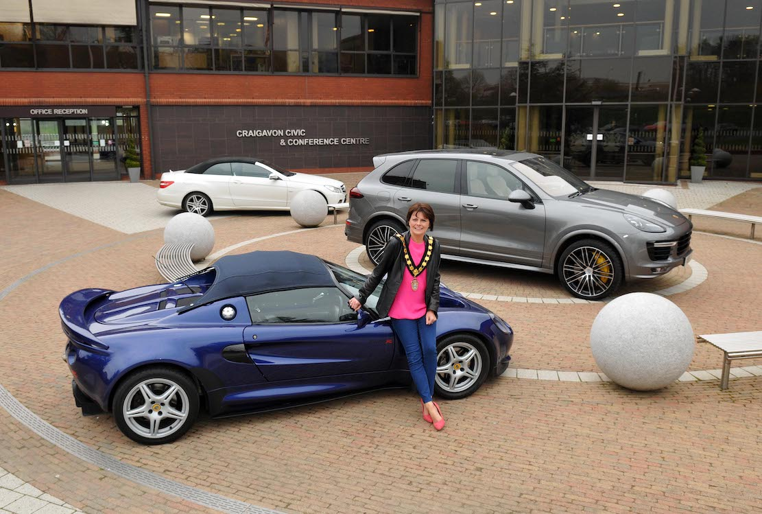 Lord Mayor of Armagh City, Banbridge and Craigavon, Councillor Julie Flaherty with a few of the cars which will be on display at the Cars, Bikes and Coffee Evening at Craigavon Civic Centre on 9th May.