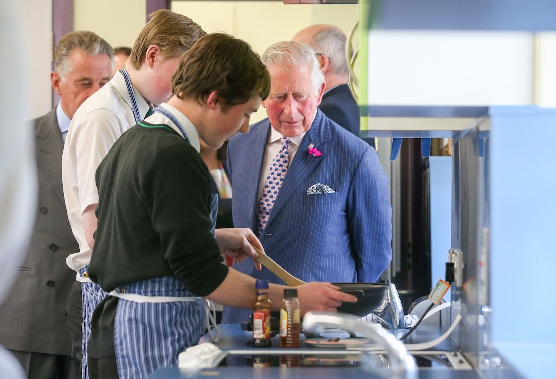 His Royal Highness The Prince of Wales met pupils at St. Patrick's Grammar School in Armagh who are taking part in the Achieve programme run by his charity, The Prince's Trust. Thomas Cullen (closed to the camera) and Cathan Kennedy demonstrate the cooking skills they have learned during the programme.
