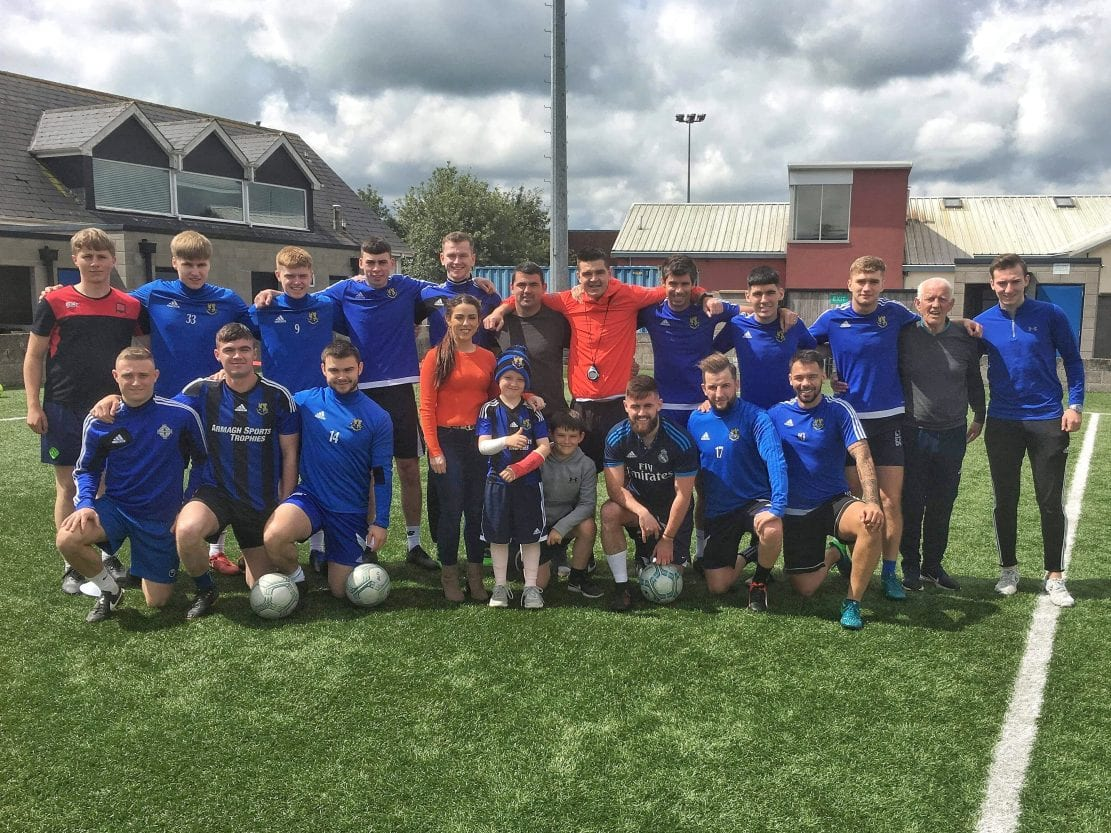 Liam Burns presented with kit bag and goodies by Armagh City FC players