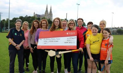 St Brigid's Camogie Club present cheque to Air Ambulance NI
